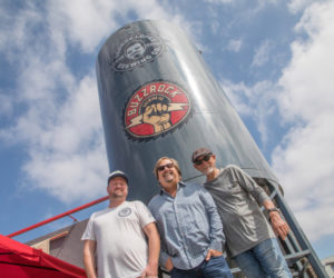 Head Brewer Justinian Caire, primary owner Michael Zislis and Dave Furano in the front of The Brews Hall silo